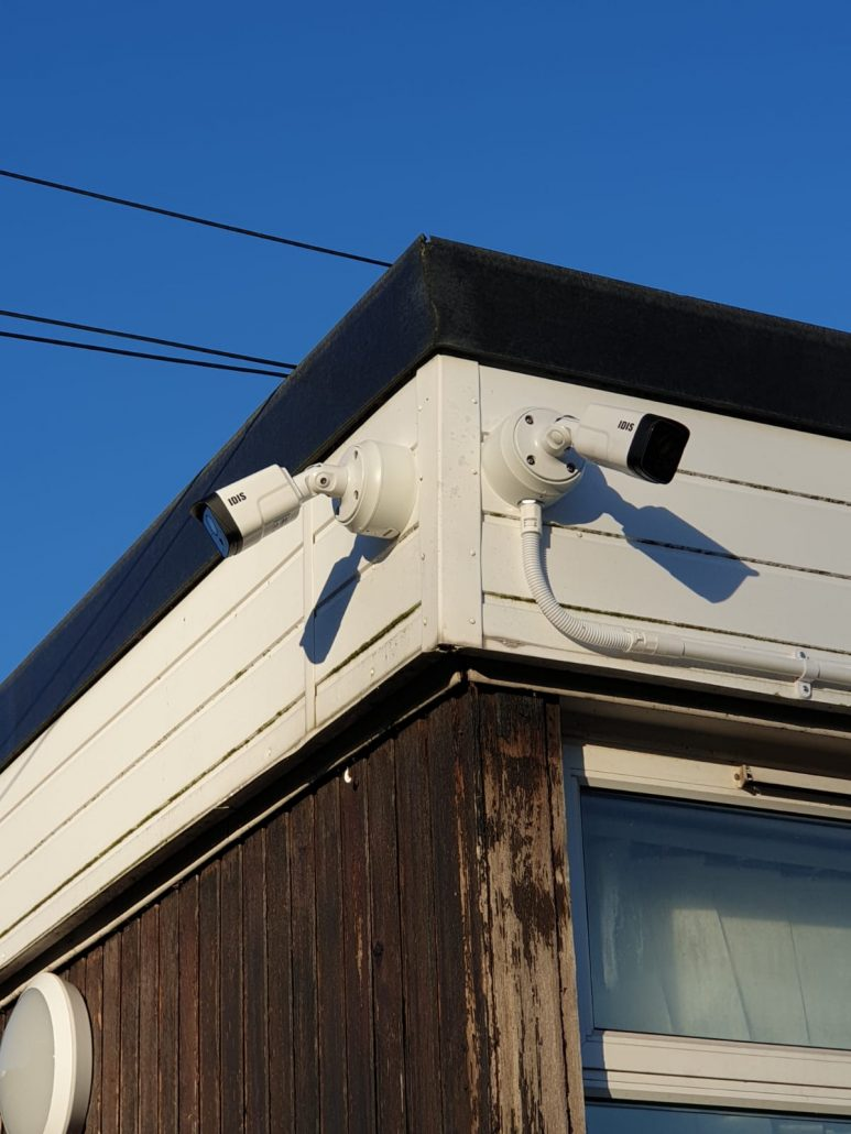 double cctv camera against a blue sky