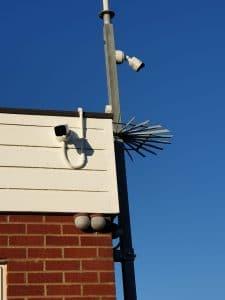 single camera against a blue sky