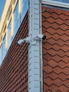 two cctv cameras pointing other ways