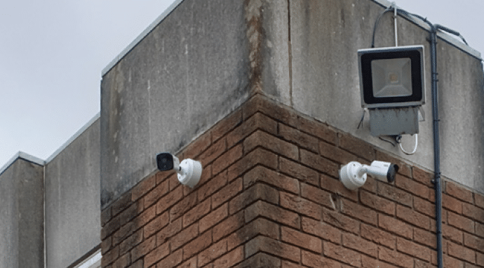 cctv attached to a wall